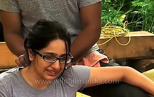 Woman gets medical rub down in Indian Himalaya.MP4