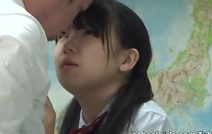Naughty Asian teen in her school uniform gets hard gender