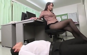 Japanese office-worker gives an enticing footjob